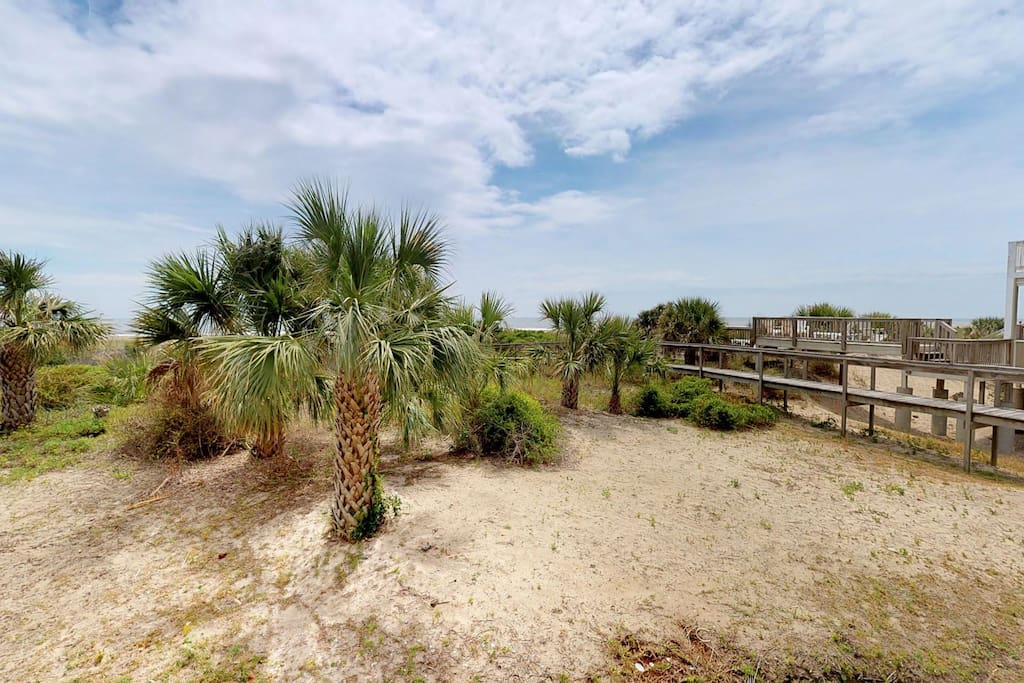 Looking out over the protected dunes, you can see the boardwalk out to the beach, accessible directly outside the unit.