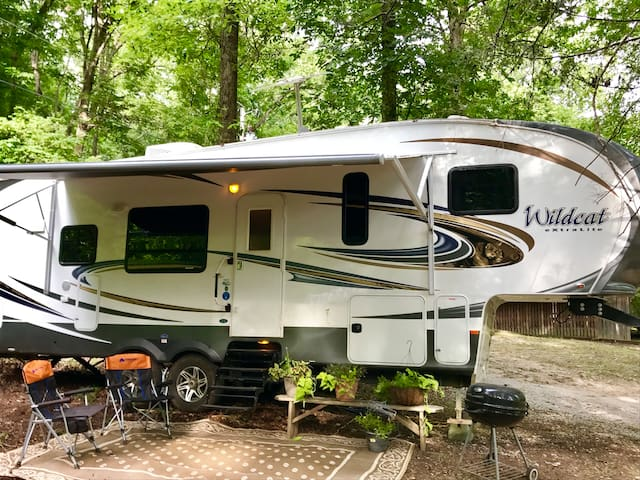 Riverfront Luxury Camper with Mountain Views