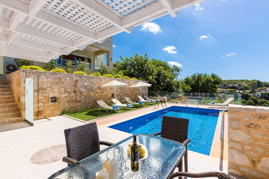 Shaded dining area next to the pool terrace!