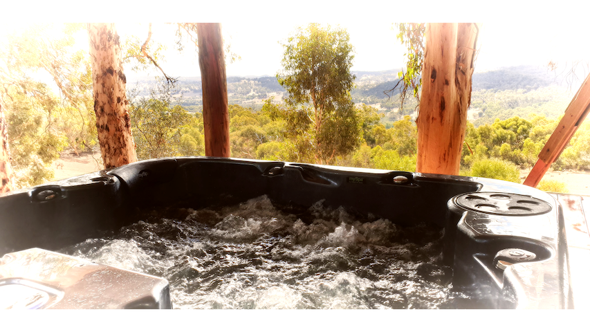 Recharge, Romance and Rest in the amazing outdoor jacuzzi under the gum trees with towering views over The Chittering Valley