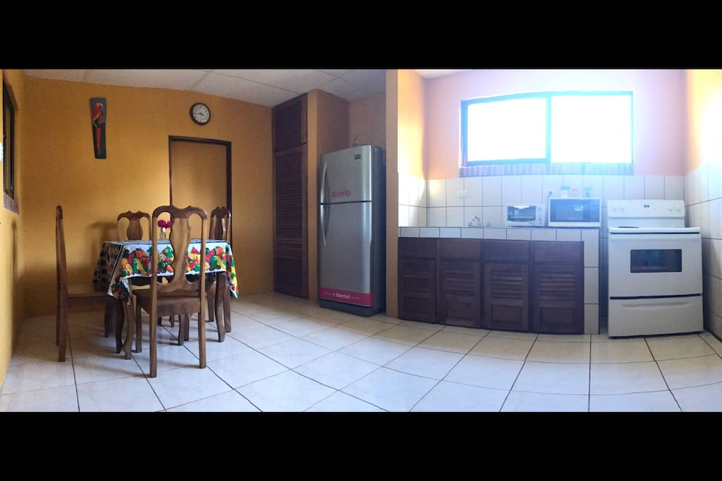 Equipated kitchen and dining room.
