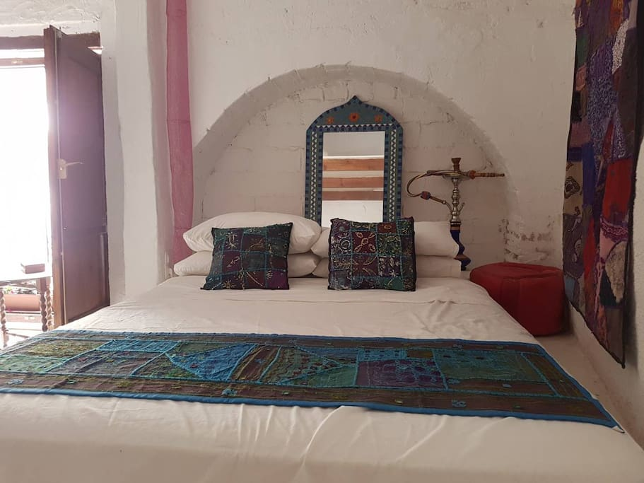 Large bedroom 3 beds sleeps 5 people , balcony and private bathroom