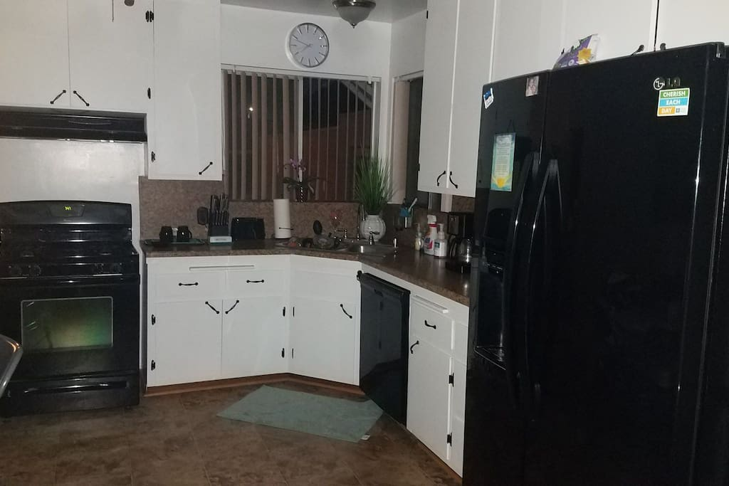 Full stocked kitchen. Dishes , pots and pans silverware. microwave blender, coffee maker