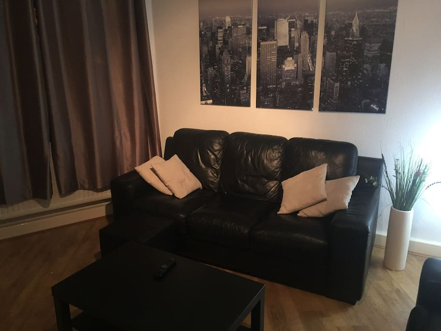 Lounge with 3 seater and 2 seater sofas. There is a desk space. We have a smart tv with freeview