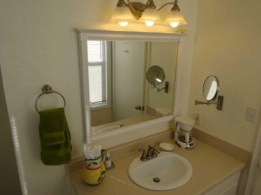 Bathroom vanity, hair dryer included.