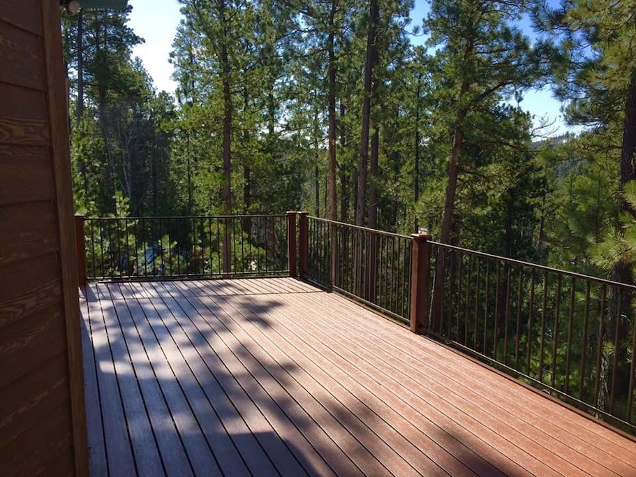 New spacious deck that over looks our 9+ acres of private land.  Also on deck during summer months are table and chairs and gas grill