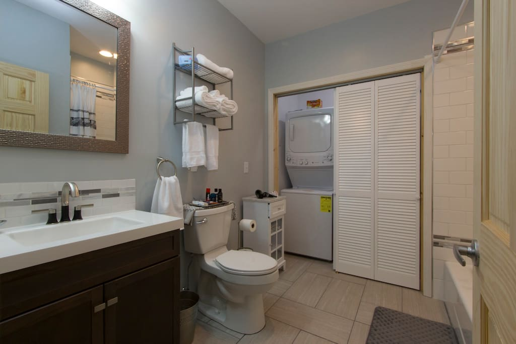 Sparkling clean huge Private bathroom and laundry facility.