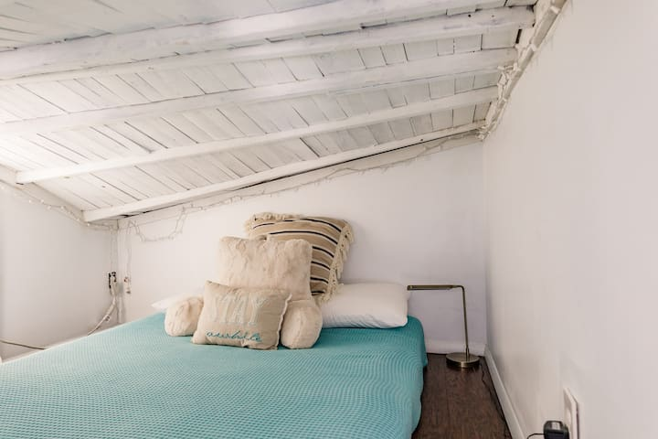 Queen bed in the upstairs loft!  There are also fun lights at night :)