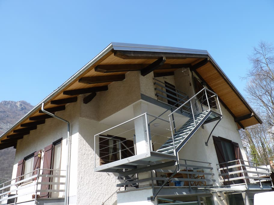 The house. The apartment for guest is under the roof with private access.
