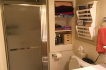 Bathroom with fully-stocked shower, clock radio, hair dryer, first aid kit