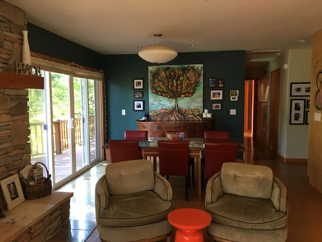 Great room - family room with wood burning fireplace, sliding doors to deck and hot tub, dining room table with seating for 6.