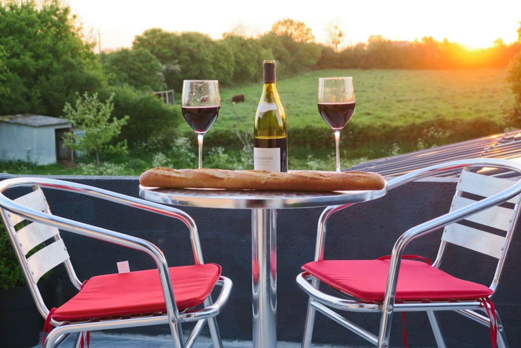 sunset, wine & Normandy cows - bit of a tranquil setting!