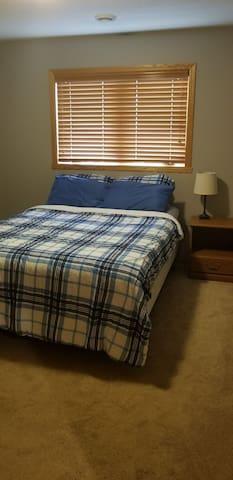 Bedroom 1, pic 1.  (Queen bed, nightstand)