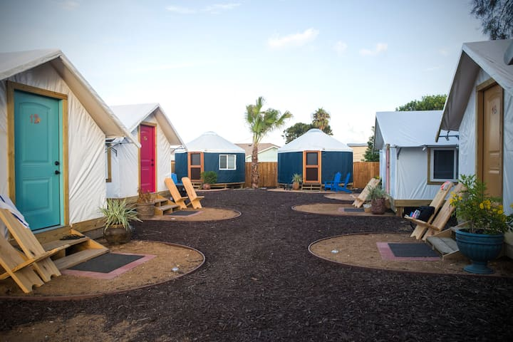 Camp coyoacan tent bungalow 16 cabins for rent in port for Fishing cabins for rent in texas