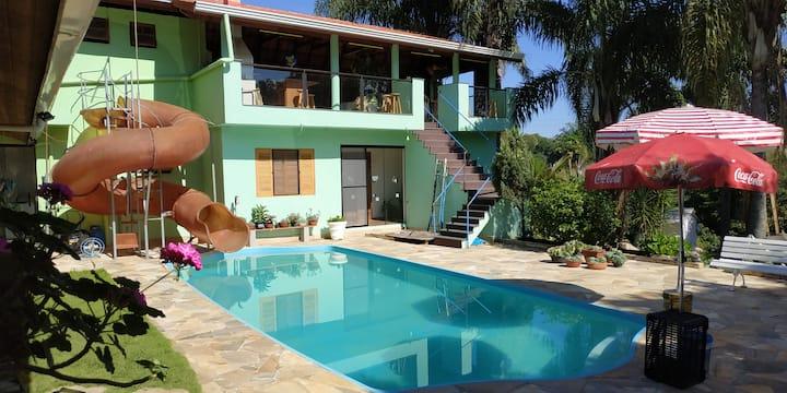 House condominium w/ pool, water slide, BBQ & Wifi