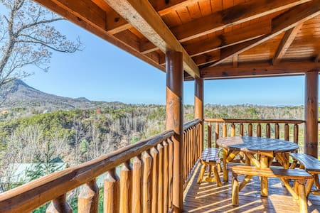 Stunning log cabin w/ mountain views, a private hot tub, & shared pool