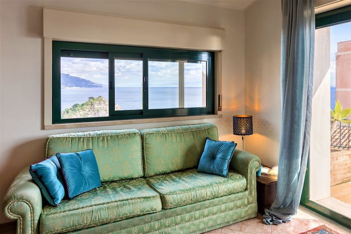 Living room with incredible sea view opens on terrace
