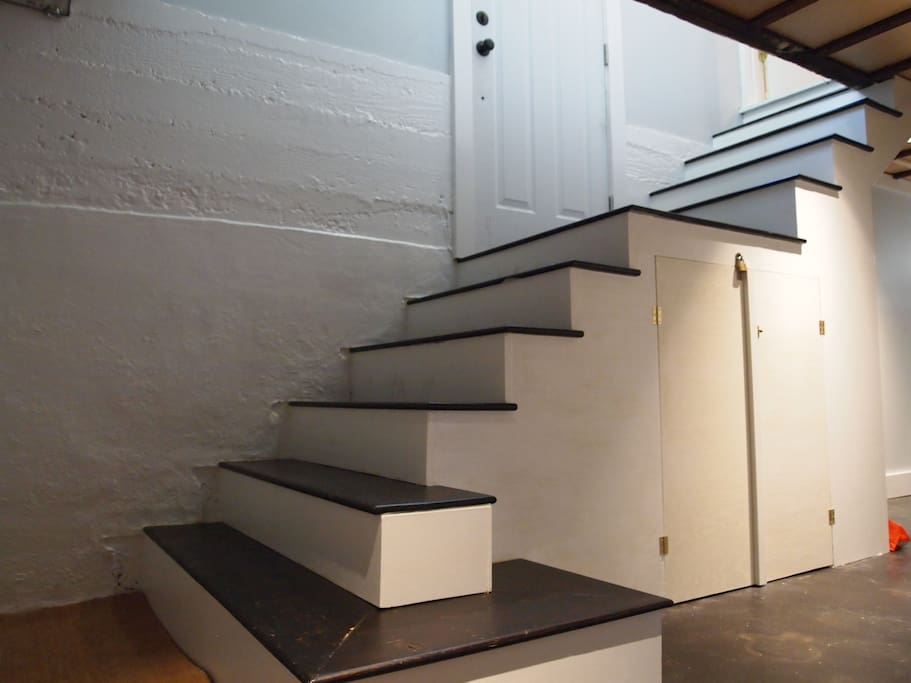 Stairs down from the private entrance.