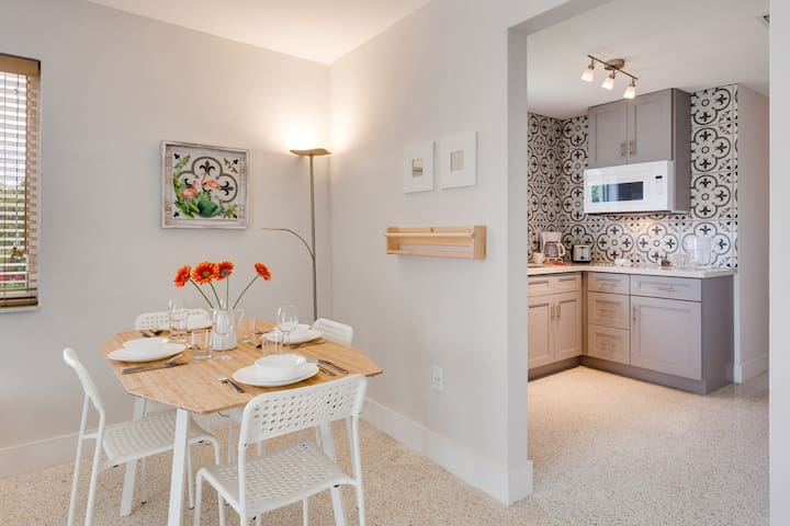 Dining table and Kitchen,  we have two stools to allow 6 guests to eat when needed.