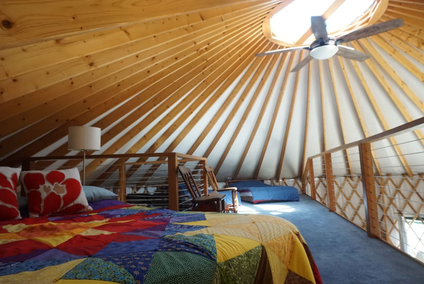 Upstairs in the loft is a cosmic queen bed and a set of twin beds.