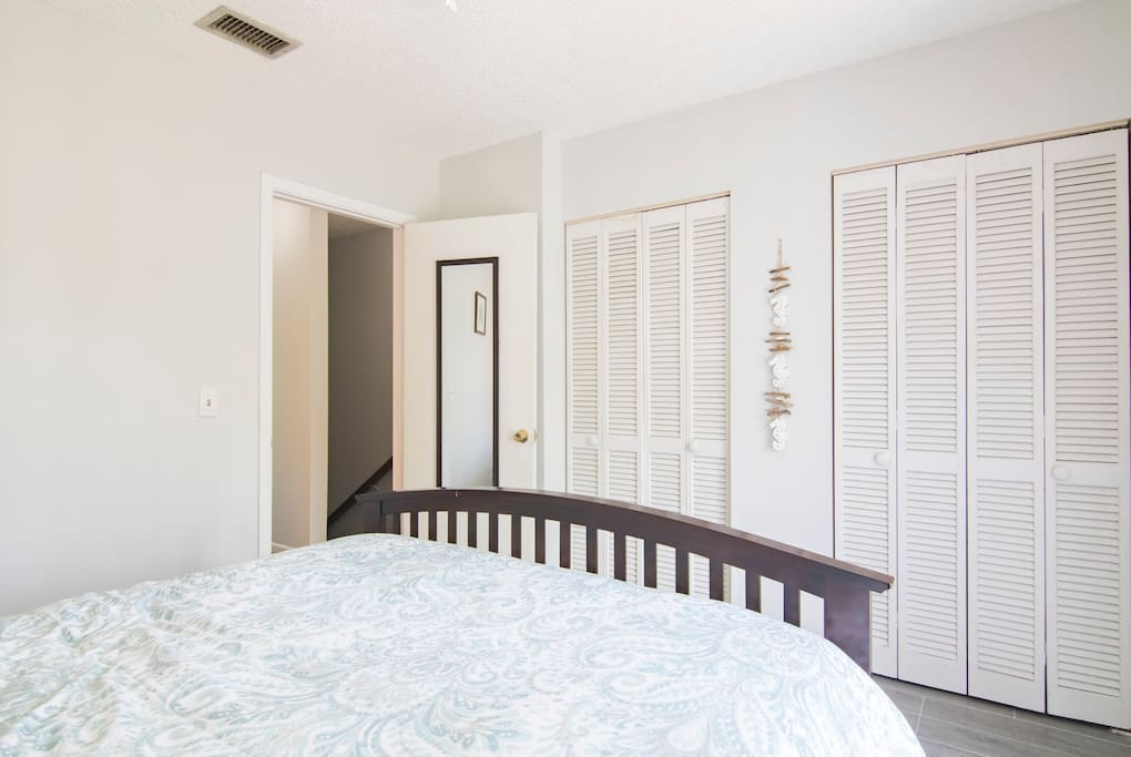 Double closets with hangers in Master Bedroom