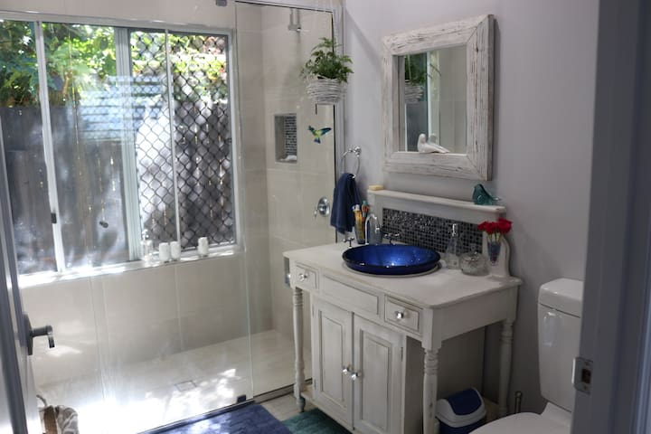spacious bathroom with double shower