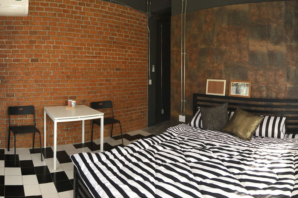Spacious room with king size latex bed and working/dining area
