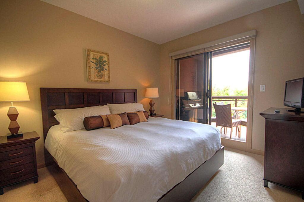The Master Suite has a King bed, ensuite complete bathroom and sliding glass door leading to the patio. Other features include flatscreen TV, large dresser for storage and a walk-in closet