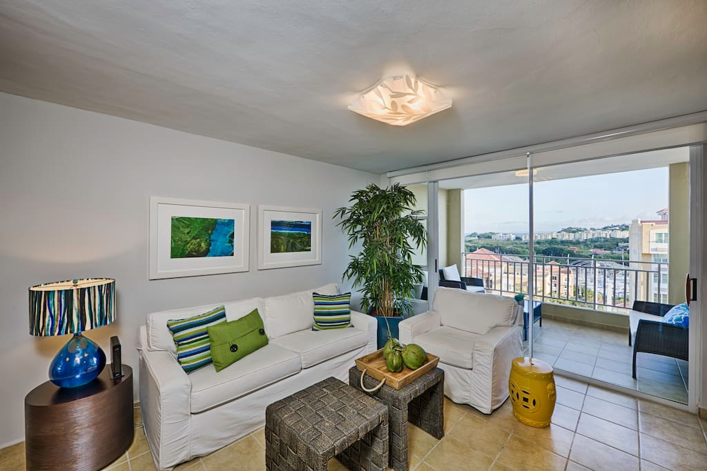 Living room with great views of the marina and lush tropical gardens