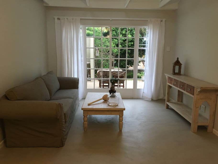 Lounge has large french doors oepning out to patio and garden and has 2.2 meter sofa which can easily be used as a spare bed. A 32 in ch plasma LED television is available with access to full cable channels