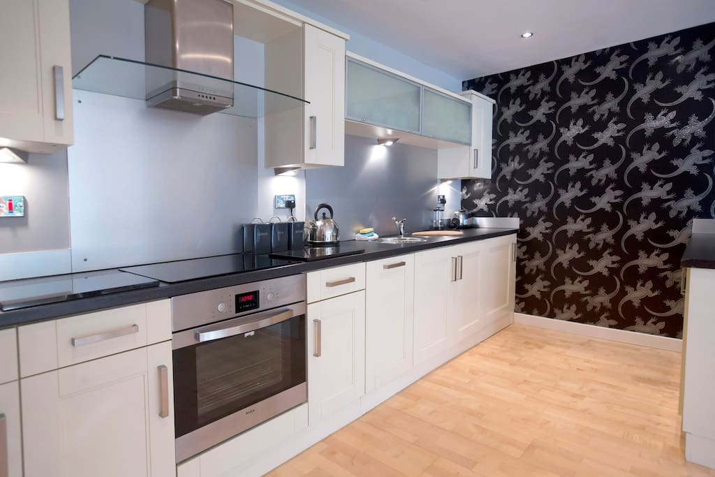 The spacious kitchen comes fully equipped with everything yo need for your stay