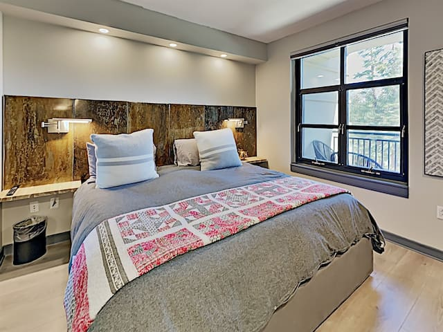 The master bedroom includes imported bedding, down duvet, and designer quilt.