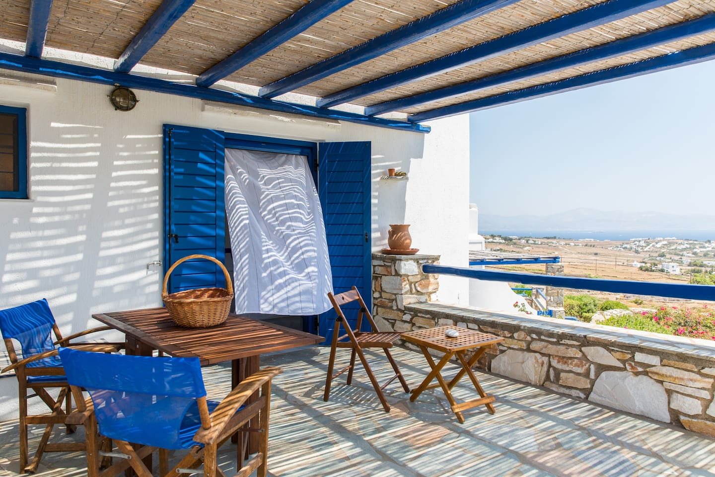 The 1st floor terrace from where you can enjoy the magnificent view of the nearby Cycladic islands and the Aegean sea