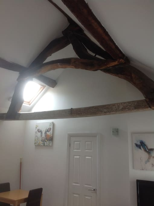 Original Chapel beams offering a high ceiling in the open plan living space