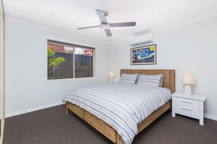 The main bedroom. King bed. Split system. Ceiling fan. Robe for your belongings & en-suite with toilet, vanity/sink & shower.