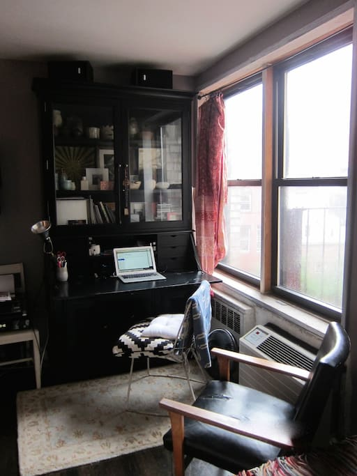 writing desk next to window - apt has high speed qifi