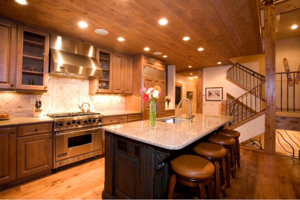 The beautiful island kitchen is big enough to accommodate the Emeril, Bobby Flay, and Rachel Ray of the group all at once.