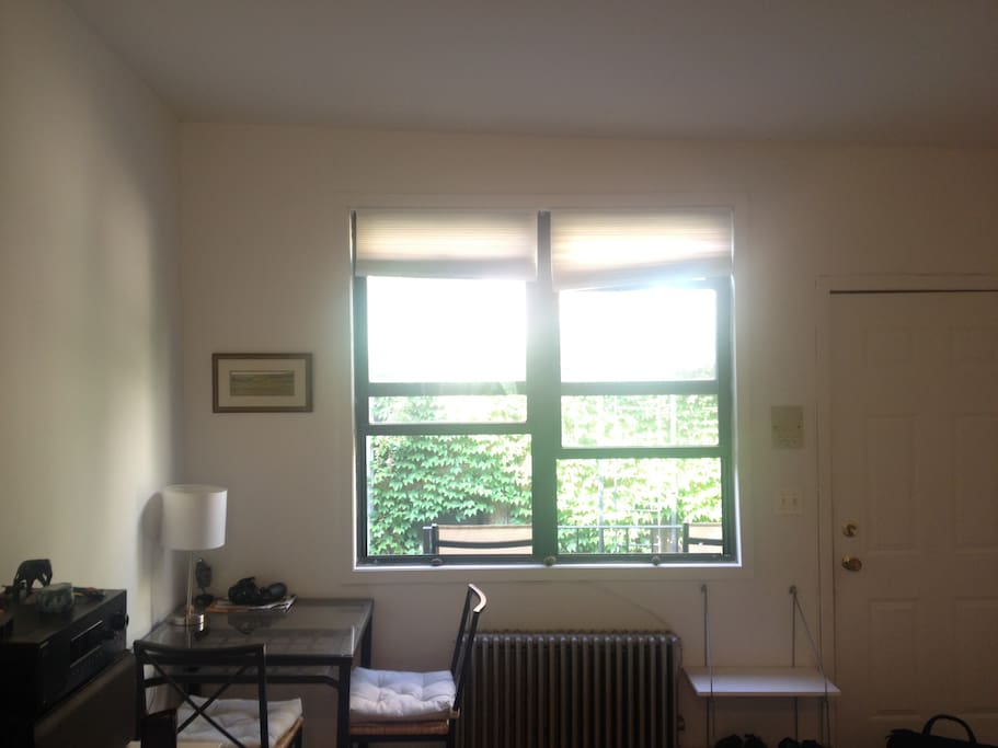 Beautiful sunlight everyday. Apartment has instant access to outdoor space that includes two chairs and a table