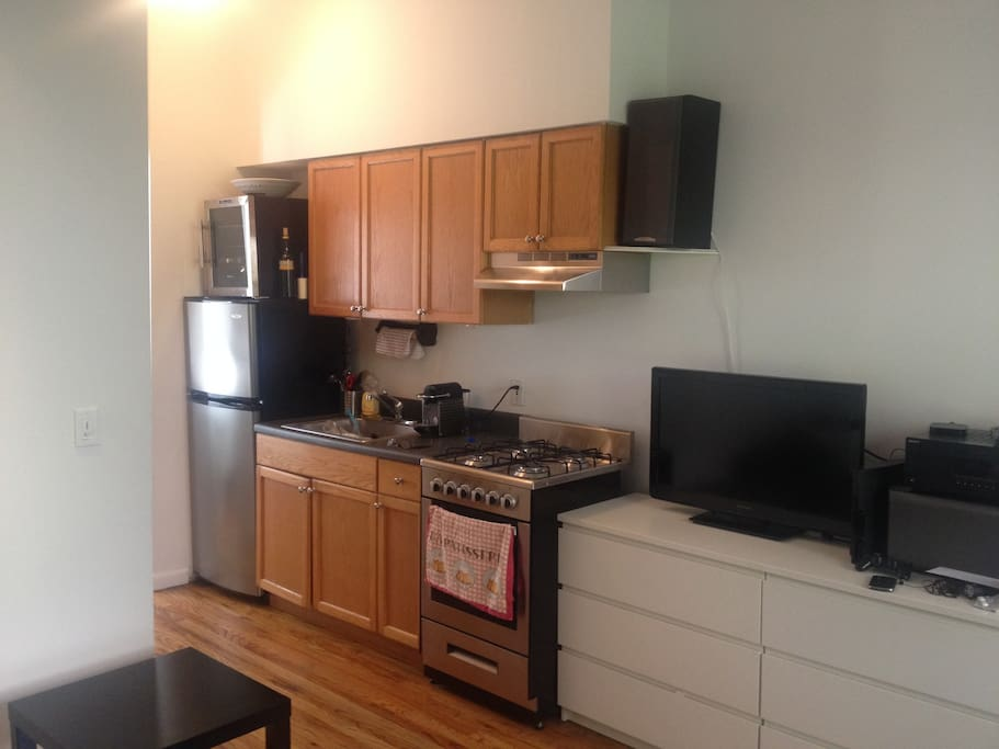 Enjoy espresso while watching tv or listening to music on our amazing sound system. Kitchen includes new refrigerator, oven and wine fridge. Living room also includes PlayStation 3 and multiple DVDs and games.