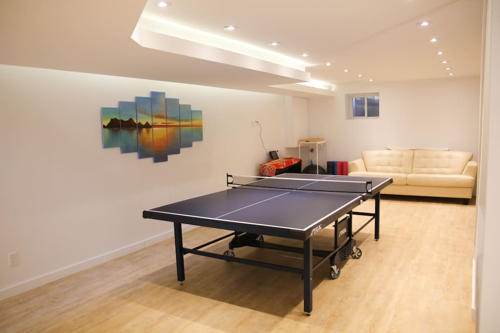 basement, ping pong table, piano, couch
