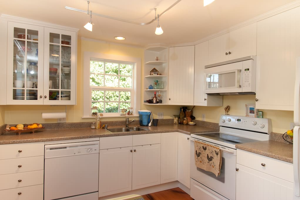the well-equipped kitchen is available for cooking; cabinets are labeled to help guests find breakfast and other items.