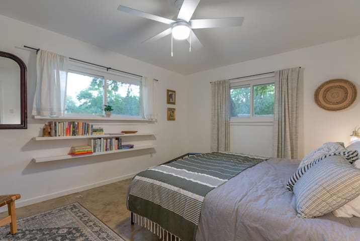 The master bedroom features a king bed and lovely natural light.
