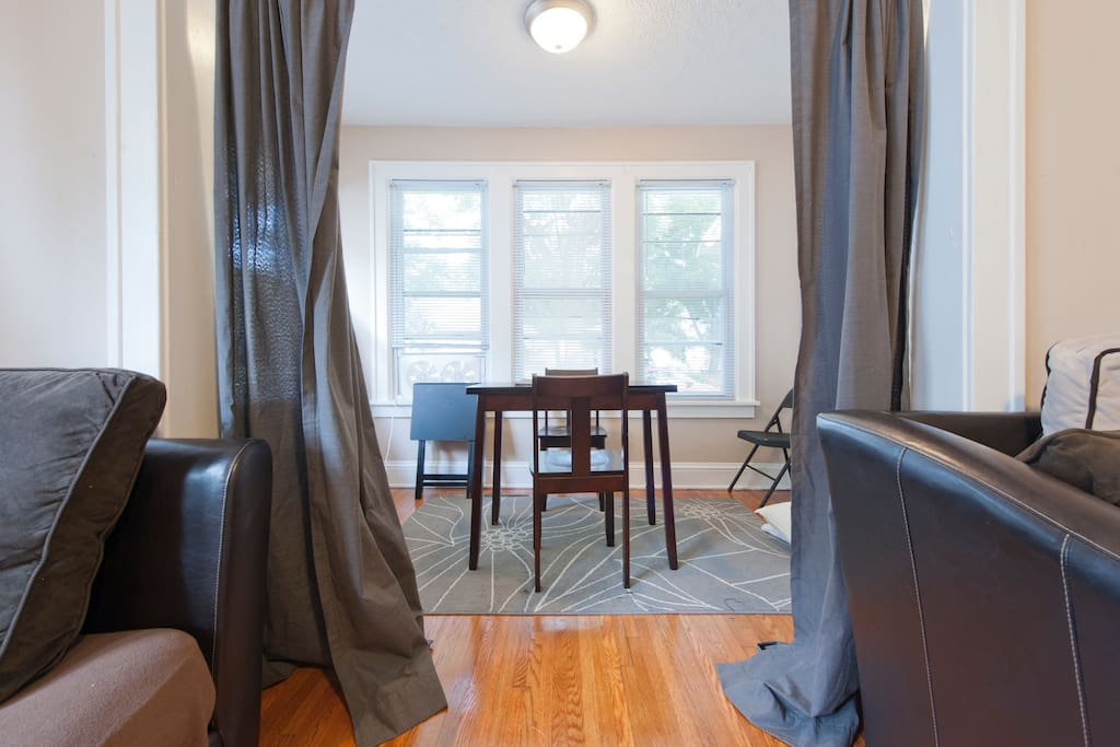 Elegant drapes and clearly waxed flooring with carpets