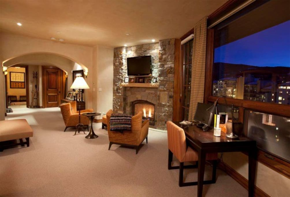 This isn't the living room. It's Master Bedroom #1, complete with a fireplace and views of Mountain Village below.