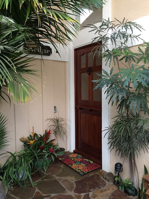 Very private atrium type front entrance, with waterfall greeting you home!