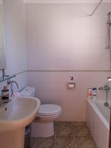 Separate bathroom in bedroom 1