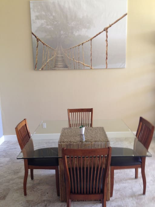 "53"" square glass dining table with 4 dining chairs provides ample space for family game night or simply group dining."