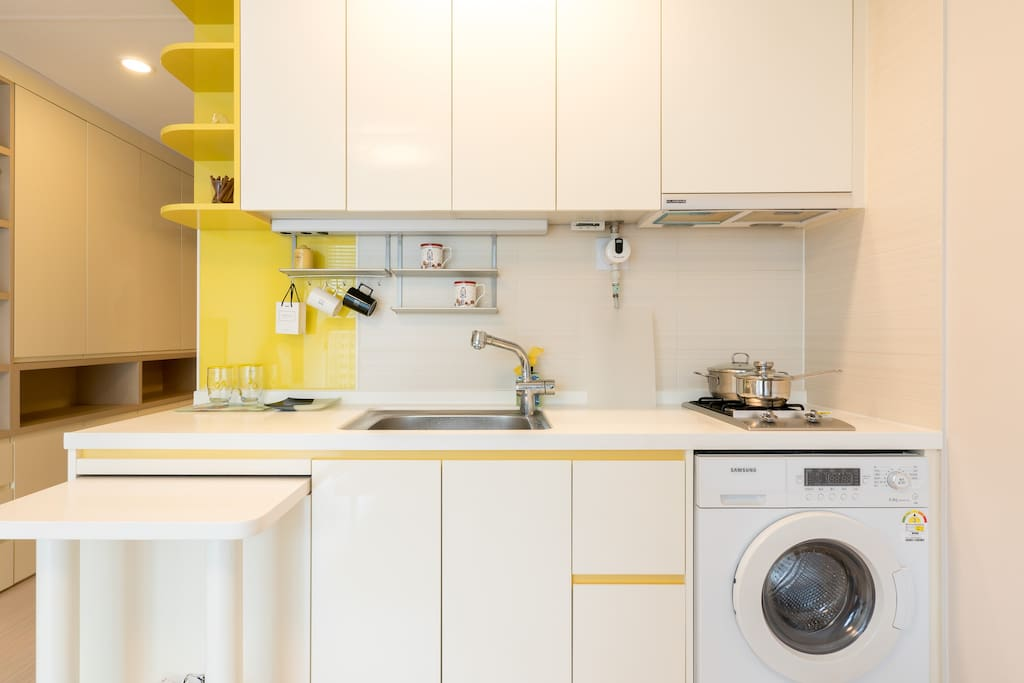 Built-in fridge, laundry in a new condition