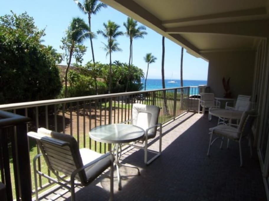 Relax on your lanai overlooking the landscaping below and the ocean.