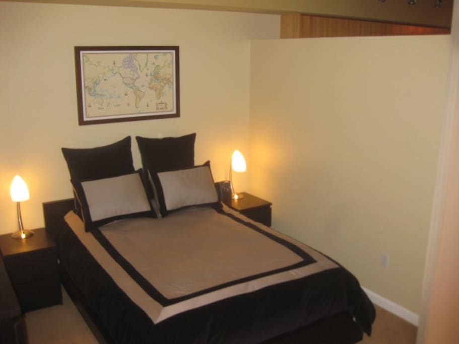 Open 1 bedroom capable of being closed off for privacy purposes with sliding curtains.